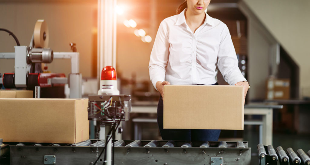 Young latina woman working in the warehouse.